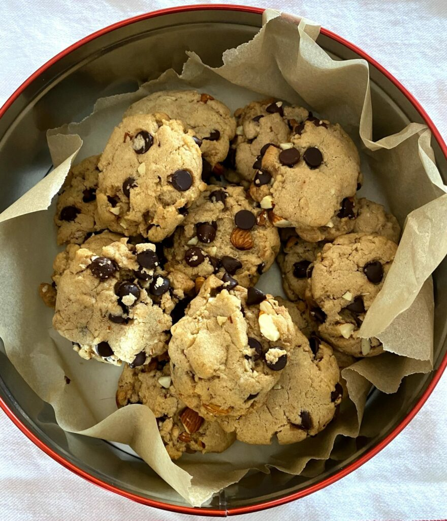 a tin of chocolate chip cookies with chocolate chips and nuts