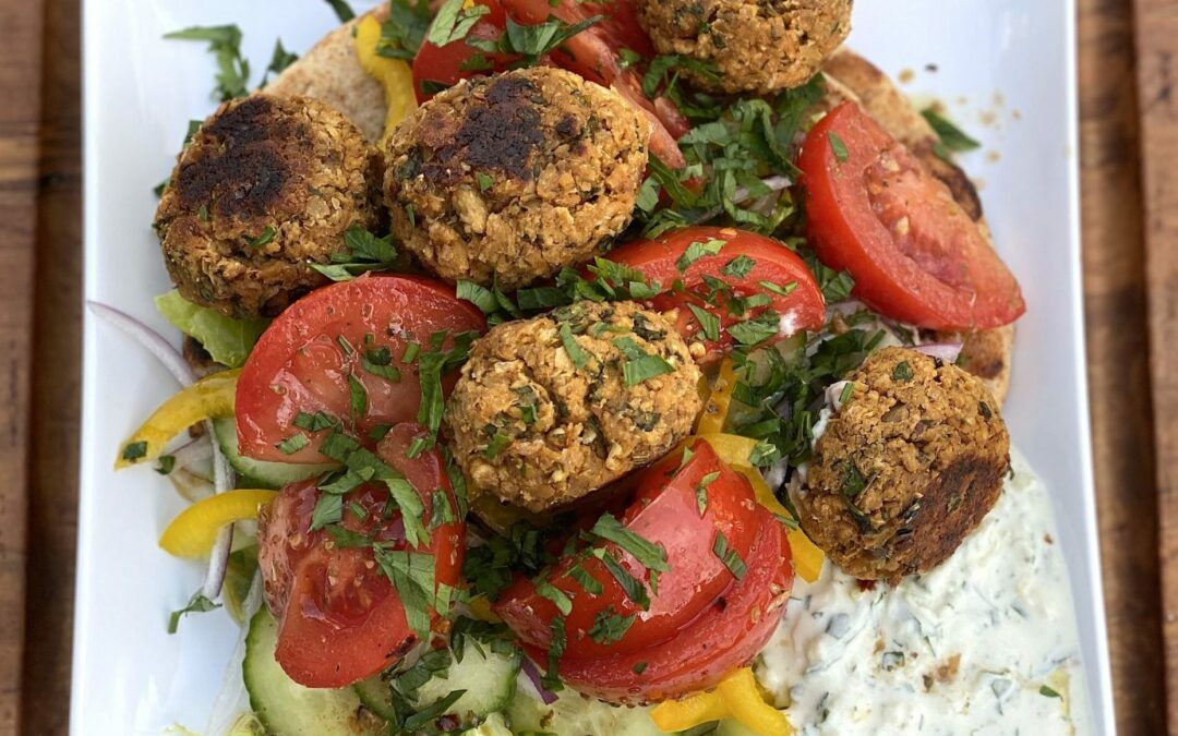 A Flavorful Falafel Plate with Tahini Sauce and Tzatziki